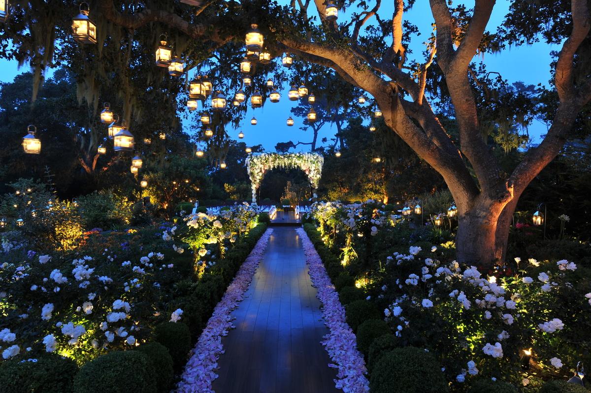 Garden wedding lantern lights hanging from trees