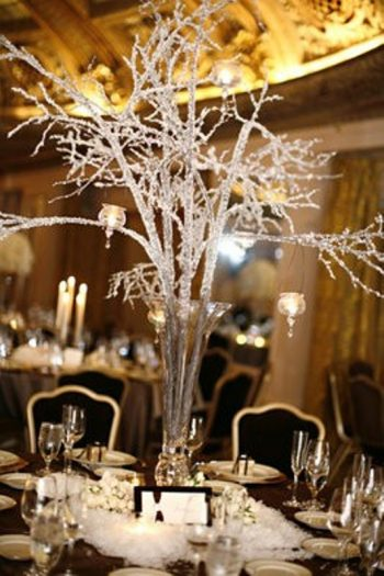 glittered branches as a winter wedding centerpiece