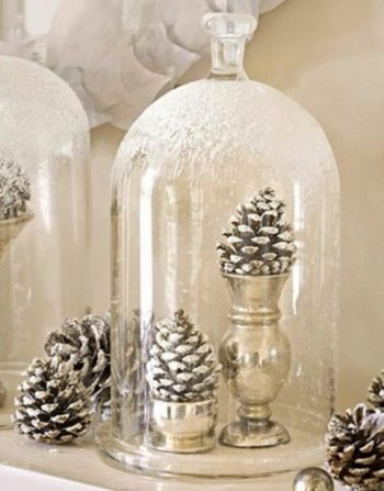 Pincones sprayed with metallic paint for a winter wedding centerpiece idea.