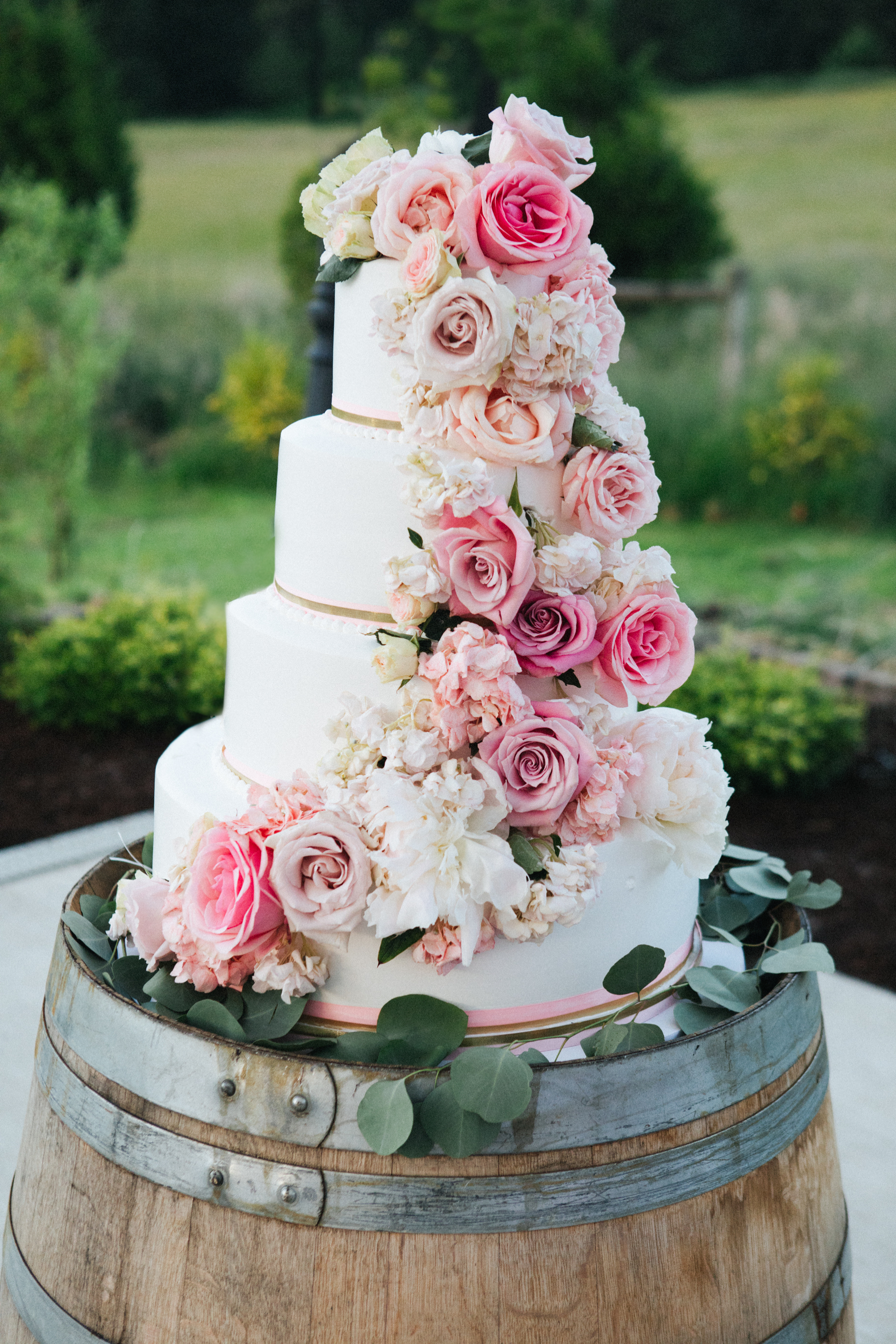 Did you know that wooden barrels make the perfect cake stand? Look here for all of our country barn reception decor ideas. You'll love them.