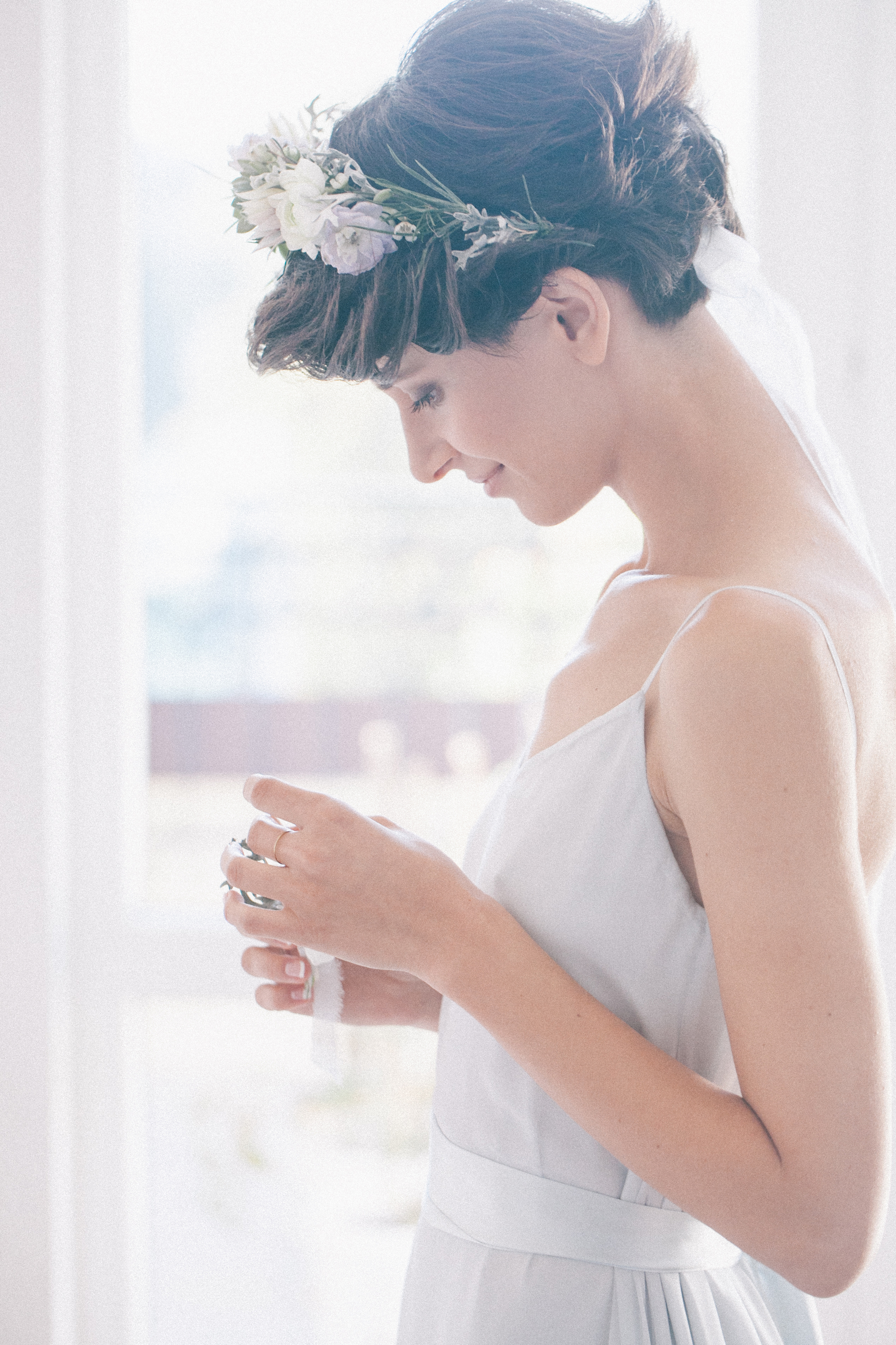 If you have short hair, it can be hard to style it for your wedding. Try adding a flower crown to your look. It will make you feel like a princess.