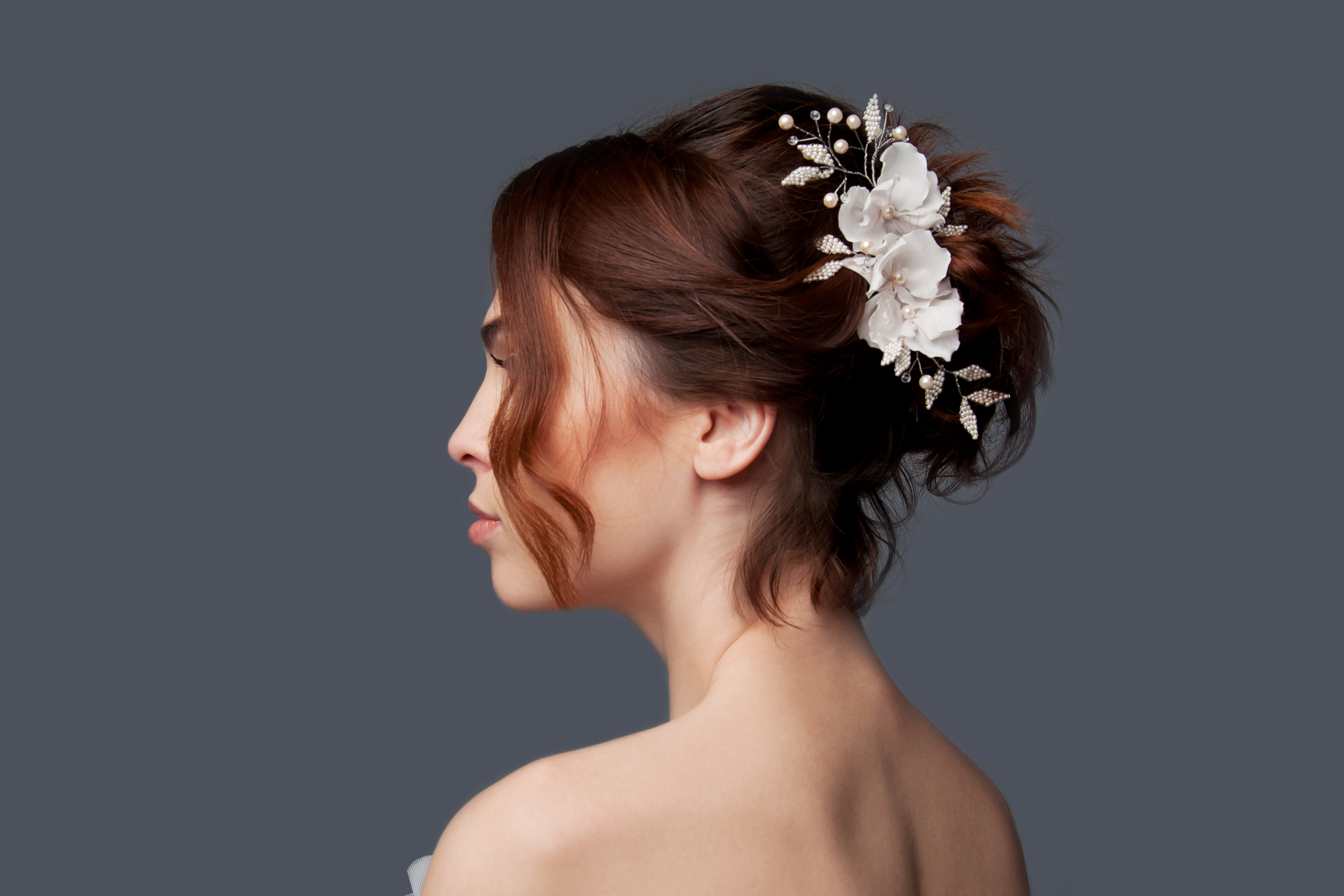 Updos can be kind of tricky for your wedding if you have short hair. Try doing an updo and adding a flower crown to it. It will look amazing!