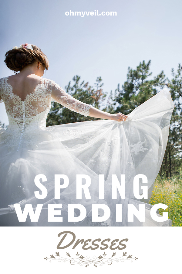 A spring wedding dress has to represent what spring does. It should be light, airy, and simply stunning. That's what we are featuring in this article. Take a look at these dresses that are stunning. Ideas for dresses with lace, sleeves, ballgown styles and more. Enjoy some color with pink that creates a whimsical look. Maybe tulle is your thing? Embrace the beauty of spring with a dress that is equally refreshing as a spring day. #springweddingdresses #weddingtips
