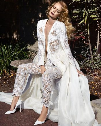 Are you looking for something a little bit different and definitely ultra-chic? Tuxedo dresses or a white lace pant suit is your answer! You will be the trendiest bride around with this white lace pant suit!
