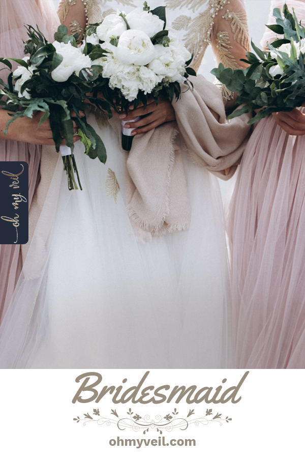 Coming up with a bridesmaids dress that everyone will like is hard work! Use my tips and tricks to find one perfect for your entire bridal party. I promise its possible! Check out this article for tons of incredible bridesmaid dress ideas for your big day. #bridesmaid #wedding #weddingideas #ohmyveilblog