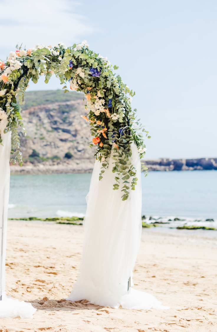 Whether you choose to do your ceremony under one, or if you just want one to take photos under, a DIY wedding arch is a must-have for any bride this year. The options you have for flowers on arches is endless!