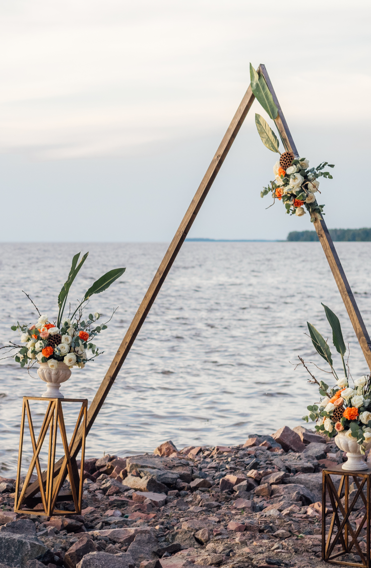 Whether you choose to do your ceremony under one, or if you just want one to take photos under, a DIY wedding arch is a must-have for any bride this year. You can even do a fun shape like a triangle!